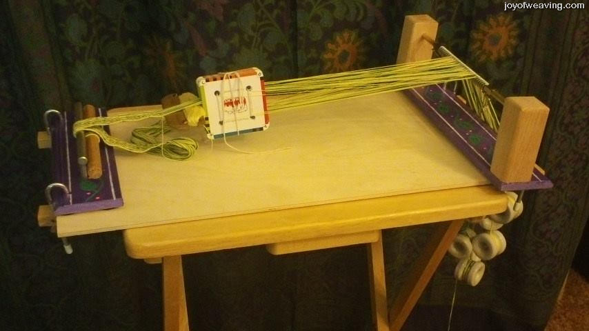 Easy DIY Tablet Weaving Loom clamped to a tv tray table.