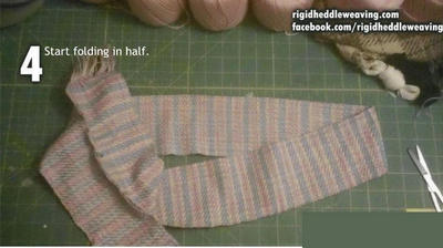Start to fold the cloth in half.